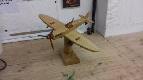 Wooden Spitfire on stand